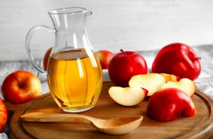 Apple Cider Vinegar With Spoon and Apples
