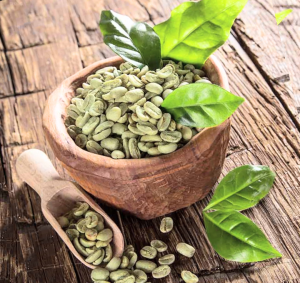 Green coffee beans with spoon